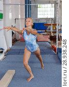 Купить «Happy beautiful woman gymnast training gymnastic action at gym», фото № 28938248, снято 18 июля 2018 г. (c) Яков Филимонов / Фотобанк Лори