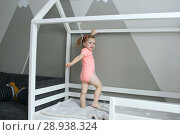 Купить «Cute lovely 2 years little girl in her bed at home», фото № 28938324, снято 20 июля 2018 г. (c) ivolodina / Фотобанк Лори