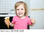 Купить «Happy lovely little toddler girl eats ice-cream at home», фото № 28938328, снято 4 августа 2018 г. (c) ivolodina / Фотобанк Лори
