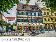 Купить «Scooters parked outside a beer Keller in Ulm, Germany.», фото № 28942708, снято 19 ноября 2019 г. (c) age Fotostock / Фотобанк Лори