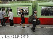 Купить «Pjoengjang, North Korea, a platform overseer in front of a waiting subway», фото № 28945016, снято 9 августа 2012 г. (c) Caro Photoagency / Фотобанк Лори