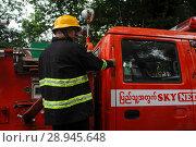 Купить «Yangon, Myanmar, Fire Department is rushing to a deployment in the center», фото № 28945648, снято 30 июля 2013 г. (c) Caro Photoagency / Фотобанк Лори