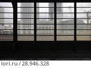 Berlin, Germany, window facade in Zoologischer Garten station, in the background new buildings on Breitscheidplatz in Berlin-Charlottenburg (2016 год). Редакционное фото, агентство Caro Photoagency / Фотобанк Лори