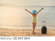 Купить «Beautiful young woman standing with suitcase on the wonderful sea background, concept of time to travel», фото № 28947864, снято 19 апреля 2018 г. (c) Happy Letters / Фотобанк Лори
