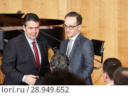 Купить «Berlin, Germany - The outgoing Foreign Minister Sigmar Gabriel and the new Foreign Minister Heiko Maas at the ministerial change in the World Hall of the Foreign Ministry.», фото № 28949652, снято 14 марта 2018 г. (c) Caro Photoagency / Фотобанк Лори