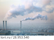 Купить «Berlin, Germany, smoking chimneys of the cogeneration plant Berlin-Mitte», фото № 28953540, снято 4 марта 2018 г. (c) Caro Photoagency / Фотобанк Лори