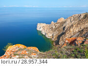 Купить «Lake Baikal in the summer. The picturesque white marble cape Sagan-Khushun (in the people of Three Brothers) in the northern part of the island of Olkhon is a tourist natural sight of the lake. A group of tourists can be seen on the rock», фото № 28957344, снято 3 августа 2012 г. (c) Виктория Катьянова / Фотобанк Лори