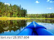 Купить «The nose of an inflatable boat on a forest lake», фото № 28957604, снято 2 августа 2018 г. (c) Юлия Кузнецова / Фотобанк Лори
