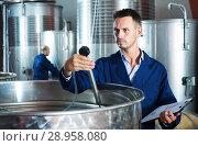 Купить «young man expert in winery», фото № 28958080, снято 16 августа 2018 г. (c) Яков Филимонов / Фотобанк Лори
