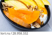 Купить «Mango and baked pumpkin with flakes and yogurt», фото № 28958332, снято 23 сентября 2018 г. (c) Яков Филимонов / Фотобанк Лори