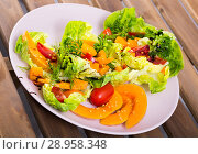 Купить «Salad of baked pumpkin, cherry tomatoes, sesame, sauce and greens», фото № 28958348, снято 21 октября 2018 г. (c) Яков Филимонов / Фотобанк Лори