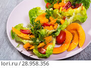 Купить «Deliciously salad of baked pumpkin, cherry tomatoes, sesame and sauce», фото № 28958356, снято 21 августа 2018 г. (c) Яков Филимонов / Фотобанк Лори