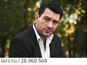 Купить «portrait of a handsome man in the park», фото № 28960564, снято 14 августа 2018 г. (c) Александр Лычагин / Фотобанк Лори