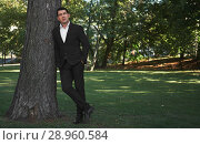 Купить «full length of a businessman standing in the park», фото № 28960584, снято 10 августа 2018 г. (c) Александр Лычагин / Фотобанк Лори