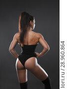 Купить «A beautiful sports brunette, back and buttocks», фото № 28960864, снято 31 июля 2018 г. (c) Restyler Viacheslav / Фотобанк Лори