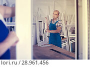 Portrait of male worker with finished plastic window in assembly. Стоковое фото, фотограф Яков Филимонов / Фотобанк Лори