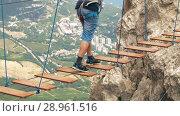 Купить «Man walking by suspension bridge», видеоролик № 28961516, снято 10 августа 2018 г. (c) Илья Шаматура / Фотобанк Лори