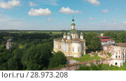 Купить «Cathedral of the Ascension of the Lord. Spaso-Sumorin Monastery. Totma. Vologda Region. Russia. view from above», видеоролик № 28973208, снято 16 августа 2018 г. (c) Mikhail Starodubov / Фотобанк Лори