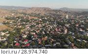 Купить «Aerial view of suburban town», видеоролик № 28974740, снято 20 июля 2018 г. (c) Илья Шаматура / Фотобанк Лори