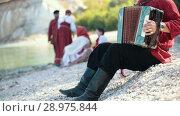 Купить «A man playing on accordion, russian national folklore and tradition», видеоролик № 28975844, снято 21 августа 2018 г. (c) Константин Шишкин / Фотобанк Лори
