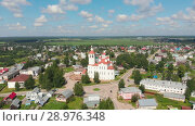 Купить «Flight of the camera over the ancient Orthodox Church. The Nativity Church, Totma, Russia. Architectural forms reminiscent of a ship. View of the church in daylight and clear weather», видеоролик № 28976348, снято 18 августа 2018 г. (c) Mikhail Starodubov / Фотобанк Лори
