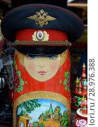 Купить «Матрешка в милицейской фуражке на рынке в Измайловском кремле. Москва», фото № 28976388, снято 7 июля 2018 г. (c) Free Wind / Фотобанк Лори
