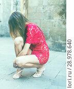 Купить «portrait of slim female in sexually red gown unshoe pumps in the street», фото № 28978640, снято 24 июня 2017 г. (c) Яков Филимонов / Фотобанк Лори