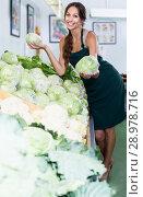 Купить «Woman holding fresh cabbage head on vegetables market», фото № 28978716, снято 14 ноября 2018 г. (c) Яков Филимонов / Фотобанк Лори