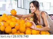 Купить «female customer picking oranges on fruit market», фото № 28978740, снято 29 мая 2020 г. (c) Яков Филимонов / Фотобанк Лори