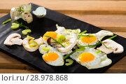 Купить «Fried quail eggs with champignons», фото № 28978868, снято 17 декабря 2018 г. (c) Яков Филимонов / Фотобанк Лори