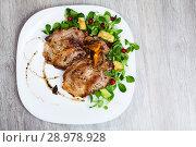 Купить «Cooked fried pork meat chops with with greens, avocado and berries», фото № 28978928, снято 17 июля 2019 г. (c) Яков Филимонов / Фотобанк Лори