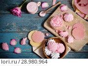 Купить «pink dessert on old dark wooden table», фото № 28980964, снято 2 мая 2017 г. (c) Майя Крученкова / Фотобанк Лори