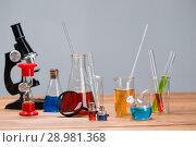 Купить «Test tubes on a table», фото № 28981368, снято 4 августа 2018 г. (c) Типляшина Евгения / Фотобанк Лори
