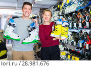 Купить «Woman and man are demonstrating their choice of ski boots», фото № 28981676, снято 31 июля 2017 г. (c) Яков Филимонов / Фотобанк Лори