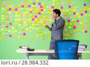 Купить «The businessman with many conflicting priorities», фото № 28984332, снято 24 мая 2018 г. (c) Elnur / Фотобанк Лори