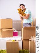 Купить «The young man moving to new apartment», фото № 28984684, снято 30 июня 2018 г. (c) Elnur / Фотобанк Лори