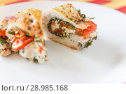 Купить «Sliced baked poultry fillet stuffed with soft cheese, tomatoes and greens on a white plate. The concept of the proper beneficial health food, diet», фото № 28985168, снято 15 апреля 2018 г. (c) Tetiana Chugunova / Фотобанк Лори