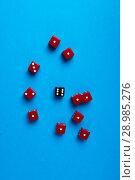 Купить «Red and black gaming dices on blue background», фото № 28985276, снято 3 января 2018 г. (c) Pavel Biryukov / Фотобанк Лори