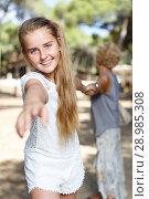 Купить «Teen girl girl pulling hand and keep grandmother on hand in green park», фото № 28985308, снято 20 июля 2018 г. (c) Яков Филимонов / Фотобанк Лори