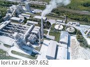 Купить «Cement factory, industrial enterprise. The smoking factory chimney.», фото № 28987652, снято 17 августа 2018 г. (c) Андрей Радченко / Фотобанк Лори