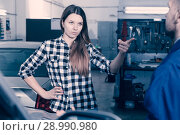 Young woman is disappointed of tire replacement of her car in sp. Стоковое фото, фотограф Яков Филимонов / Фотобанк Лори