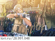 Купить «man in army uniform with weapon in military market», фото № 28991048, снято 4 июля 2017 г. (c) Яков Филимонов / Фотобанк Лори