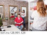 Купить «Young female hairdresser drying hair with blow dryer of guy client», фото № 28991124, снято 25 апреля 2018 г. (c) Яков Филимонов / Фотобанк Лори