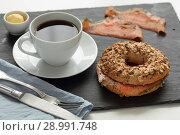 Купить «Salmon bagel sandwich and coffee», фото № 28991748, снято 4 июля 2018 г. (c) Stockphoto / Фотобанк Лори