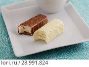 Купить «Dessert with soft cheese glazed with chocolate», фото № 28991824, снято 22 мая 2018 г. (c) Stockphoto / Фотобанк Лори