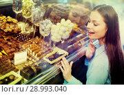 Купить «Beautiful girl choosing delicious ganaches and chocolates», фото № 28993040, снято 31 марта 2020 г. (c) Яков Филимонов / Фотобанк Лори