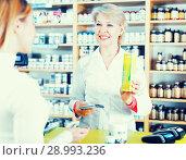 Купить «Seller helping customer to choose care products», фото № 28993236, снято 15 марта 2017 г. (c) Яков Филимонов / Фотобанк Лори