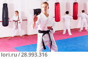 Купить «Boy in kimono exercising new techniques», фото № 28993316, снято 19 сентября 2018 г. (c) Яков Филимонов / Фотобанк Лори