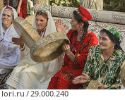 Купить «Pamiri women celebrating at the 'Roof of the World' festival in Khorog, Tajikistan.», фото № 29000240, снято 27 июля 2018 г. (c) age Fotostock / Фотобанк Лори