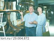 Купить «Elderly couple is shopping in the antique store», фото № 29004872, снято 21 сентября 2017 г. (c) Яков Филимонов / Фотобанк Лори